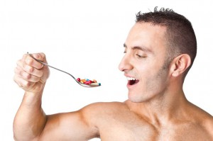 pictue of fit man with pills in spoon